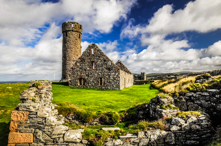 Peel Castle's tower next to Saint Patrick's Church constructed by vikings at Peel city in Isle of Man