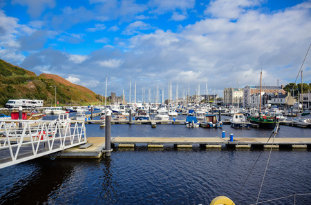 DOUGLAS, ISLE OF MAN: Yacht docking at bay in a nice small port in a clear blue sky day in a small town of Douglas, Isle of Man