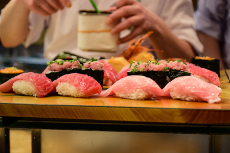 Japanese chef serving Japanese food style set of Sushi in a restaurant