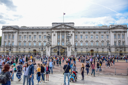 Tourist visiting Buckingham Palace, also known as Buckingham House, located in the city of Westminster, United Kingdom Editorial