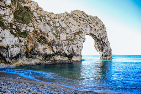 Beautiful landscape and seascape view of Durdle Door, a natural limestone arch on the Jurassic Coast near Lulworth in Dorset, England, United Kingdom