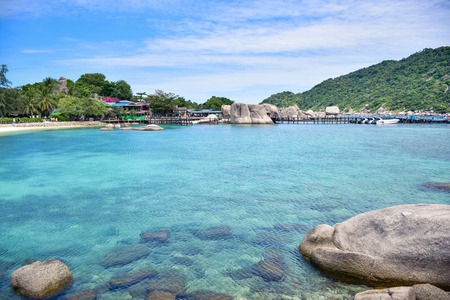 Beautiful Thailand sea beach of Nang Yuan island with clear blue sea water surrounded by green mountain in the gulf of Thailand