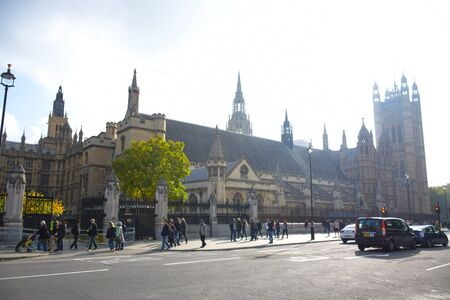 Tourists spending their time at the Palace of Westminster in central London, England, United Kingdom