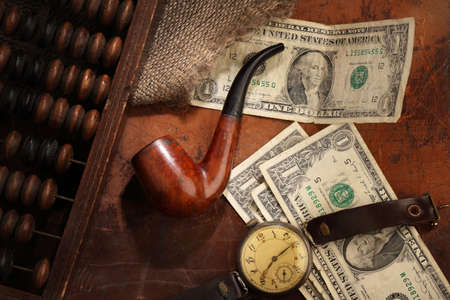 Russian money of the early twentieth century, a Smoking pipe and a glass of cognac