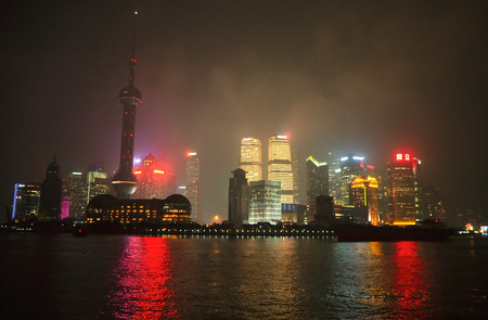 The night view of Oriental Pearl Tower, Shanghai tower, Jin Mao tower, Pudong Shangri-La, and skyscrapers in Pudong, along the Huangpu river