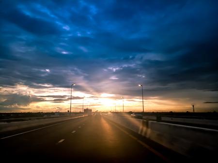 highway road , transportation road trip concept. on asphalt expressway with sunrise sky