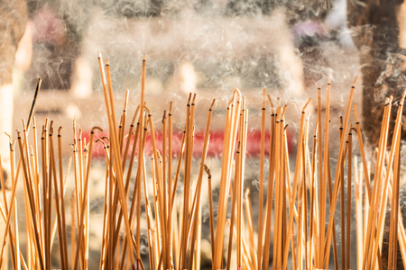 joss sticks burning at a vintage Buddhist temple courtyard as offering during Chinese New Year in temple 版權商用圖片
