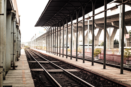 local railway station platform and traffic signage to stop people across the lanes simple architecture building design concept idea for transportation traveling