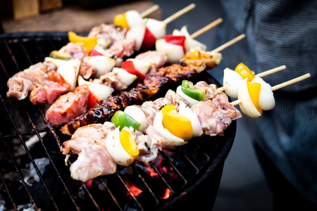 Summer or spring barbecue outdoors Close up Mouth Watering Gourmet Barbecue on Wooden Chopping Board at the Table. Stock Photo
