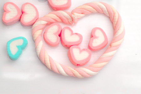Pastel Marshmallows in heart shape .concept of love.Happiness.Holiday. background