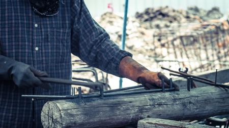 round bar bending steel on construction site for Steel stirrups component member in beam reinforcement structure. Reklamní fotografie