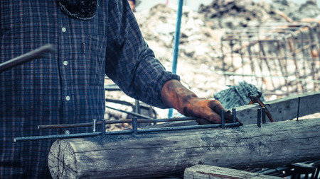 round bar bending steel on construction site for Steel stirrups component member in beam reinforcement structure. Stock Photo
