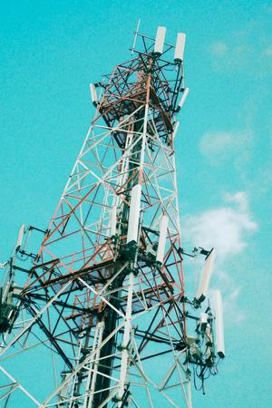 Communication antenna tower radio television digital wireless station technology against blue sky background. Zdjęcie Seryjne