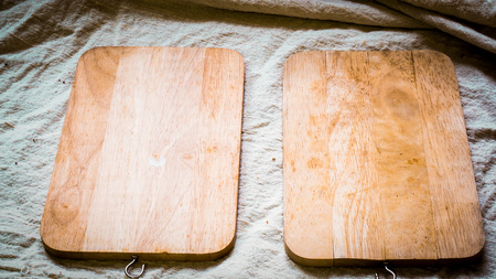 Wooden plate, on natural linen cover table on white table, top view .cooking food menu idea background