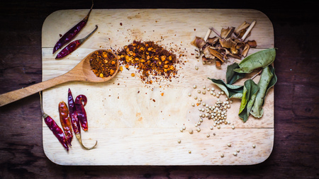 Wooden spoon with different types of quinoa Thai food ingredient and space for text on wooden table background, top view
