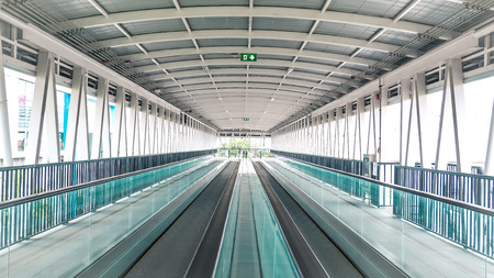 Modern walkway of escalator move forward and escalator move backward in international airport. Escalator is facility for support transportation