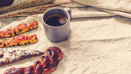 Breads and toast for breakfast with black coffee on white bed sheet background, Healthy breakfast. Morning health lifestyle concept idea background