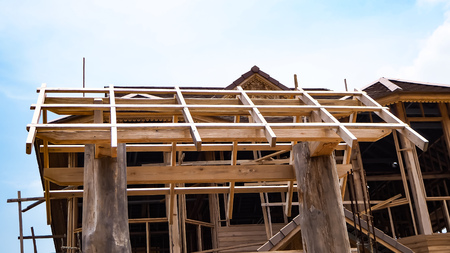 New residential construction home . the construction of a frame wooden house on a pile Foundation.