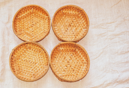 Set of Empty wicker basket on the table with a background in natural linen,Template mock up for display of product