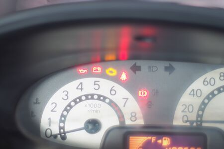 Close-up on speedometer in dashboard car. Speed gauge meter. Travel abstract concept idea background.