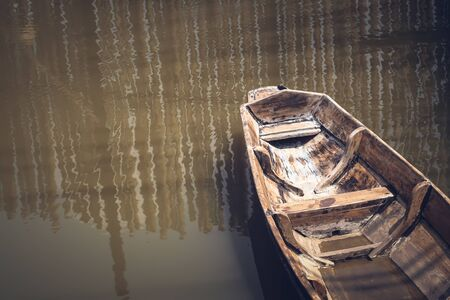 Lonely old wooden boat on the lake suburban traditional culture lifestyle