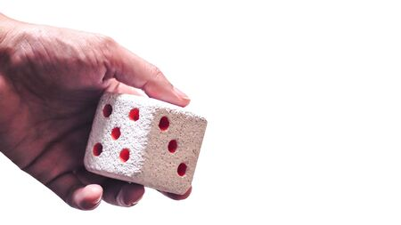 Hand & Rolling Dice. Hand rolls a dices on white isolated background. Selective focus. Dice is blur due to movement. Roll the dice concept 스톡 콘텐츠