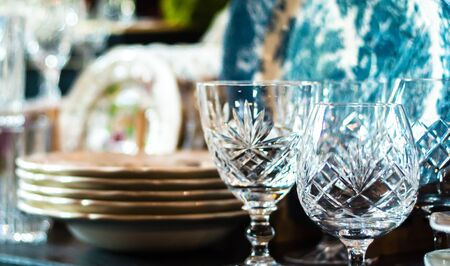 Set of Vintage crystal glasses on the black tray with Christmas decorations. Selective focus Stock fotó