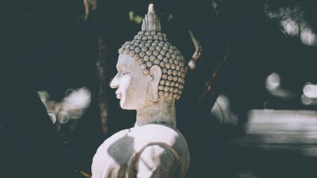 Statue of Buddha standing in meditation.Close up hand of statue Buddha.buddhism concept .peacefulness idea .lifestyle practise mind in clamness 版權商用圖片