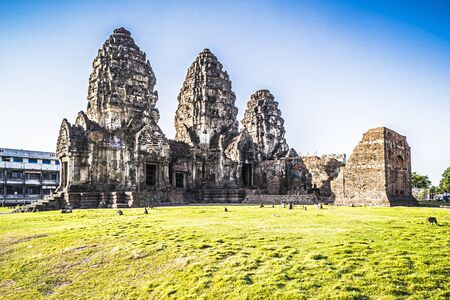 Phra Prang Sam Yod historical tourist spot in old town . Monkeys lives with ruins in Lopburi, Thailand. Religious buildings constructed by the ancient Khmer art. Asia destination of tourist
