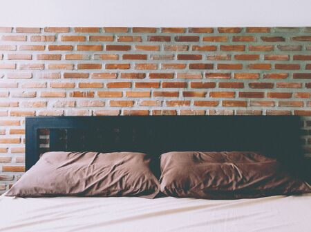Bedrooms With Exposed Brick Walls Interior Design Ideas.  brick wall behind the bed in red .strong background for an industrial design loft style .hostel hotel decoration