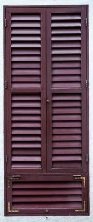 Old wooden vintage louver window. Blinds Window Shutter Plantation Shutter in brown. 版權商用圖片