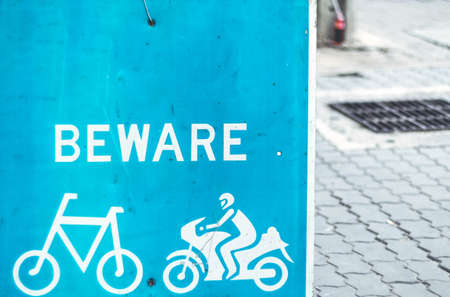 Beware Of Cyclists Road Safety blue Signage from bicycle and motorcycle on street