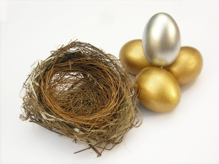 golden and silver color egg in nest          photo