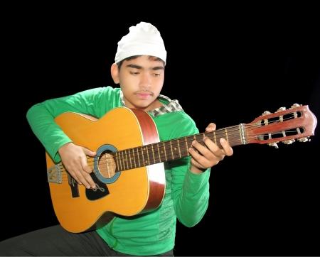 boy playing the guitar photo