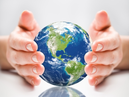 protection of land: earth globe hand  Stock Photo
