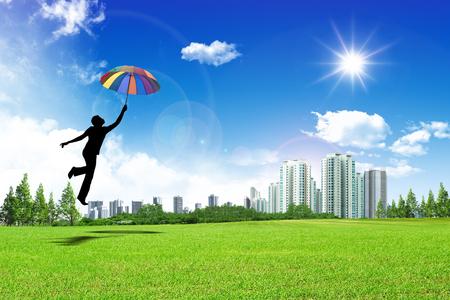 man jumping with umbrella Stock Photo