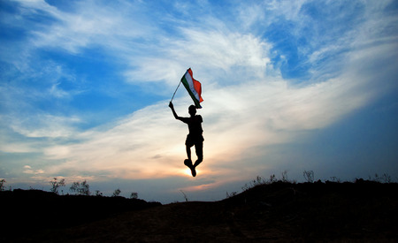 boy running with indian flag photo