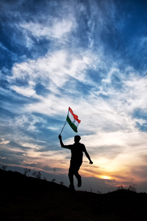 man jumping with indian flag