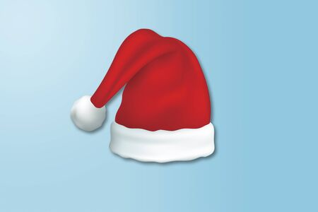 Top view of Santa clause hat on blue background