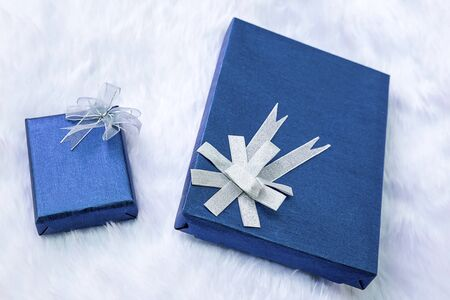 flannel: Gift boxes with sky blue on flannel background Stock Photo