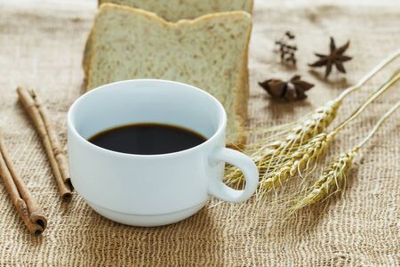 sackcloth: Black coffee  on sackcloth. Stock Photo