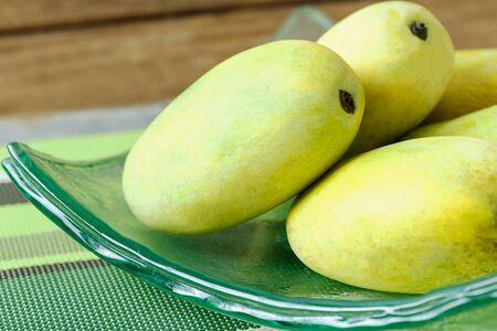 gourmet food: mango on a glass plate