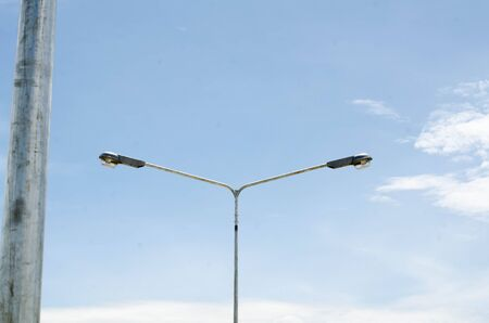 halogen: Street light with halogen lamp against blue sky.