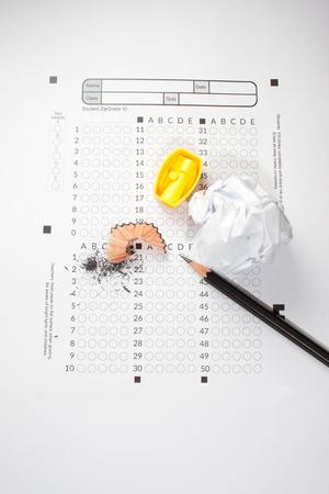 computerized: black Pencils lying on a computerized exam answer sheet.