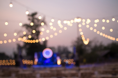 woman at night: Festival Event Party Blurred Background Stock Photo