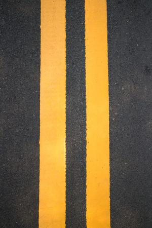 distinct: view asphalt with distinct two yellow stripes Stock Photo