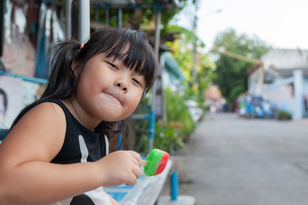 Portrait of a cute girl with ice cream on a walk in the park. child outdoors