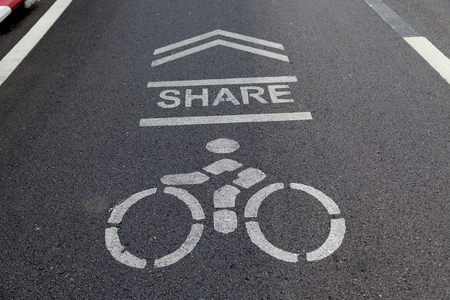 Sign on the cycling way meaning please share bike lanes for bikers.bicycles sign in the park. Zdjęcie Seryjne