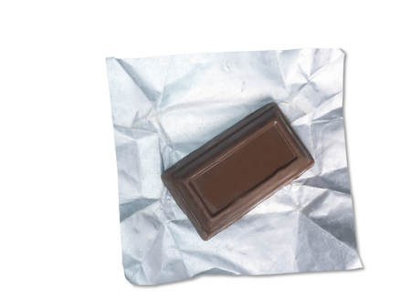 Chocolate in foil isolated on white background.