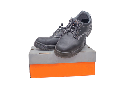 safety shoe black work boots on a white background.